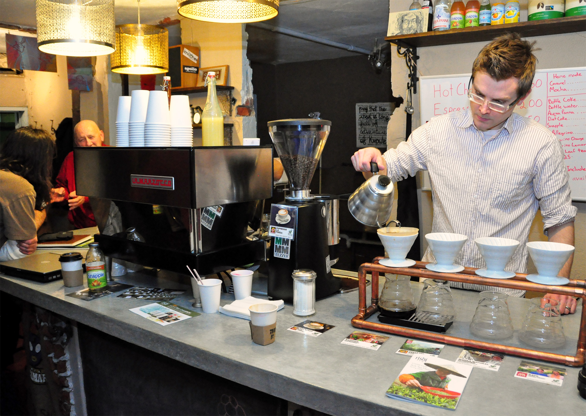 James Yoder serves coffee for the art meetup group
