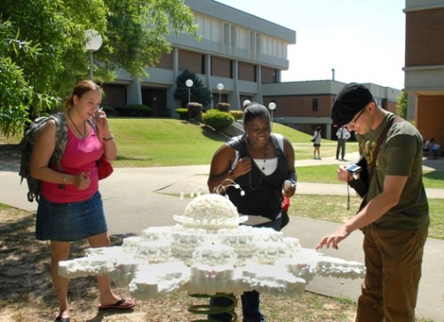Students stop to inspect Debbie Summerlin's Marshmellow Flower at AUM