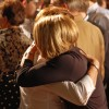 Family and friends embrace after the concession speech