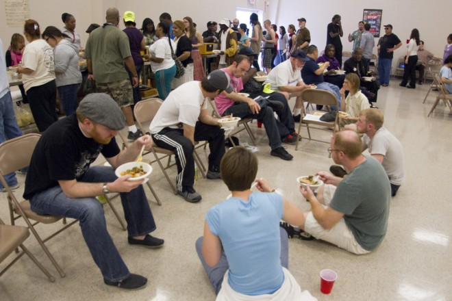 Protesters and volunteers take a dinner break at the Teamsters Local 71 Union Hall during Tuesdays day-long workshops and lectures. 5/8/12
